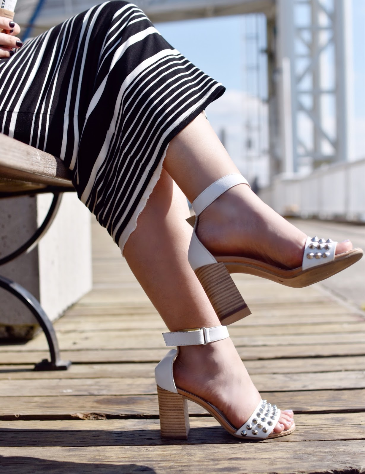 Monika Faulkner outfit inspiration - striped midi-length pencil skirt, white studded ankle-strap sandals