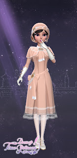 A cute peach-colored 1920s dress with ruffles, lace trim, and a curled black bob with an oversized round matching hat