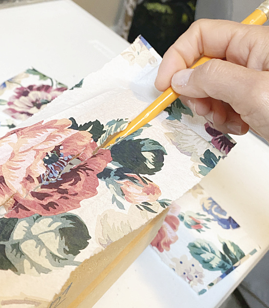 painting Mod Podge on top of the napkin