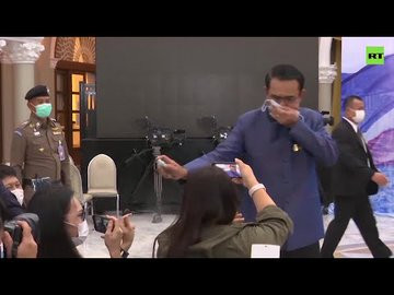 Thailand's Prime Minister Prayuth Chan-ocha sprays sanitizer on reporters to avoid answering press questions (Watch video)