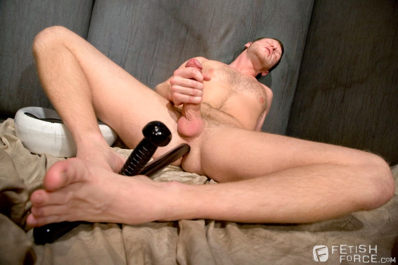 Woman using sex toy
