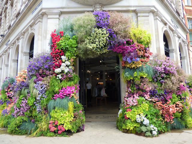 Floral arch in Sloane Square, London, for Chelsea in Bloom 2018 free flower festival
