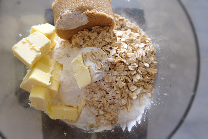 crumble ingredients in a food processor bowl