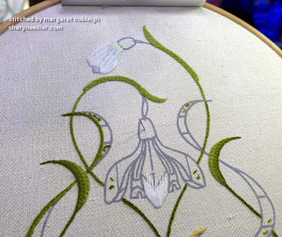 Comparing two different white crewel threads for snowdrops