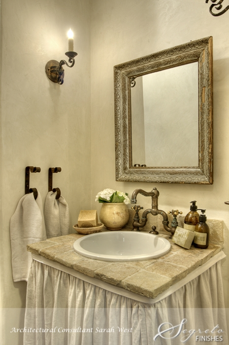 Powder room with skirted vanity. Segreto Finishes plaster walls and design details in a beautiful French country home with Old World style.