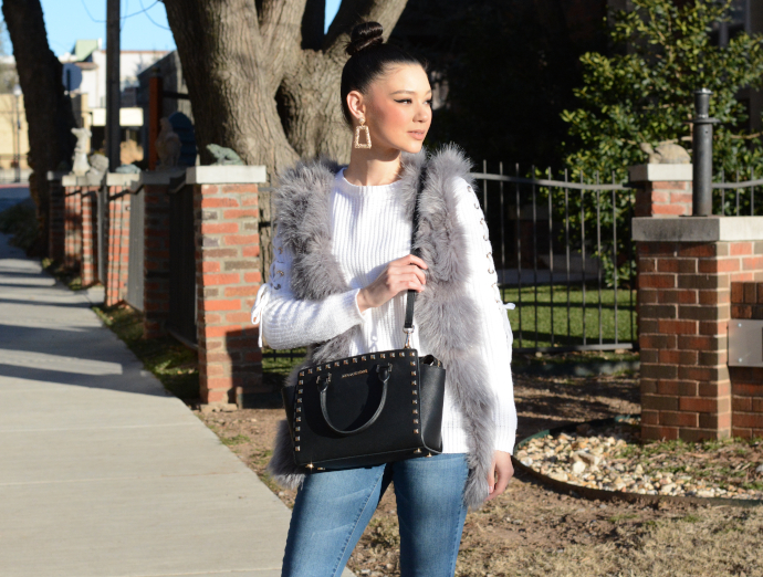grey faux fur vest, statement earrings, kitten heels