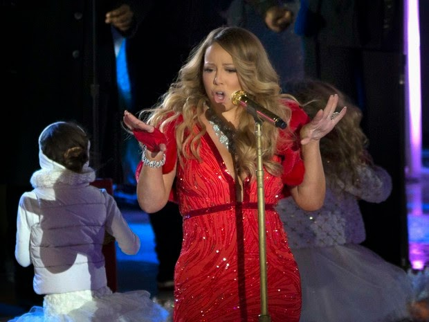 Lady in red: Mariah Carey wears sexy dress in presentation