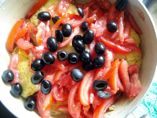 Cod with tomatoes, olives and polenta by Laka kuharica: Add tomatoes and olives, cook