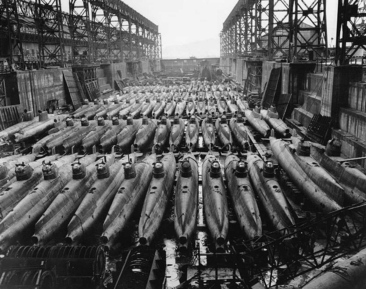 In a drydock at Kure Naval Base, Japan, 19 October 1945. There are at least four different types of midget submarines in this group of about eighty-four boats, though the great majority are of the standard