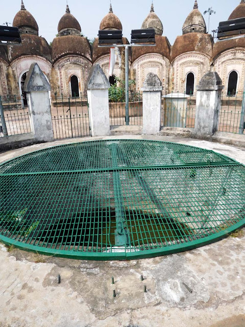 The well at the center of the inner circle of temples at the 108 Shiv Mandir or Nava Kailash in Kalna, West Bengal