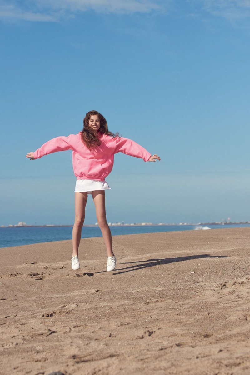 Lily Jean Harvey poses in Topshop Basic Oversized Hoodie and CATSEYE Lace Up Trainers