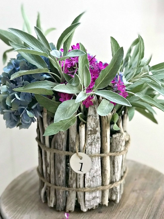 Driftwood vase for flowers with metal hang tag and flowers
