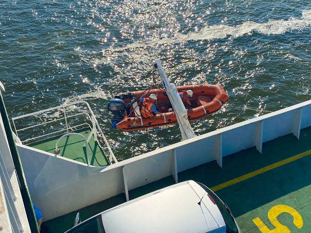 Kitten escaped car on ferry and jumped into the sea. Launching rescue boat.