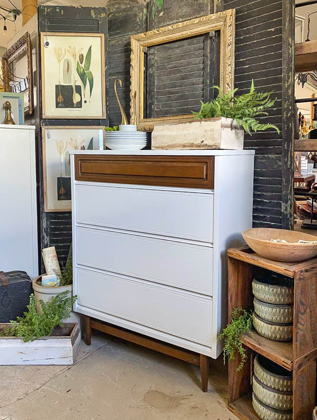 white and wood mcm dresser in vintage booth
