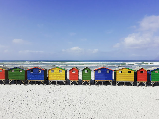 Multi-coloured beach huts Muizenberg