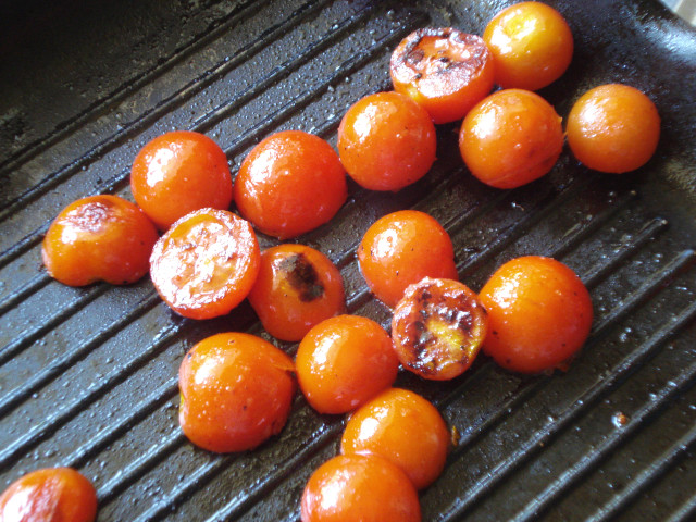 Cook cherry tomatoes in a grill pan
