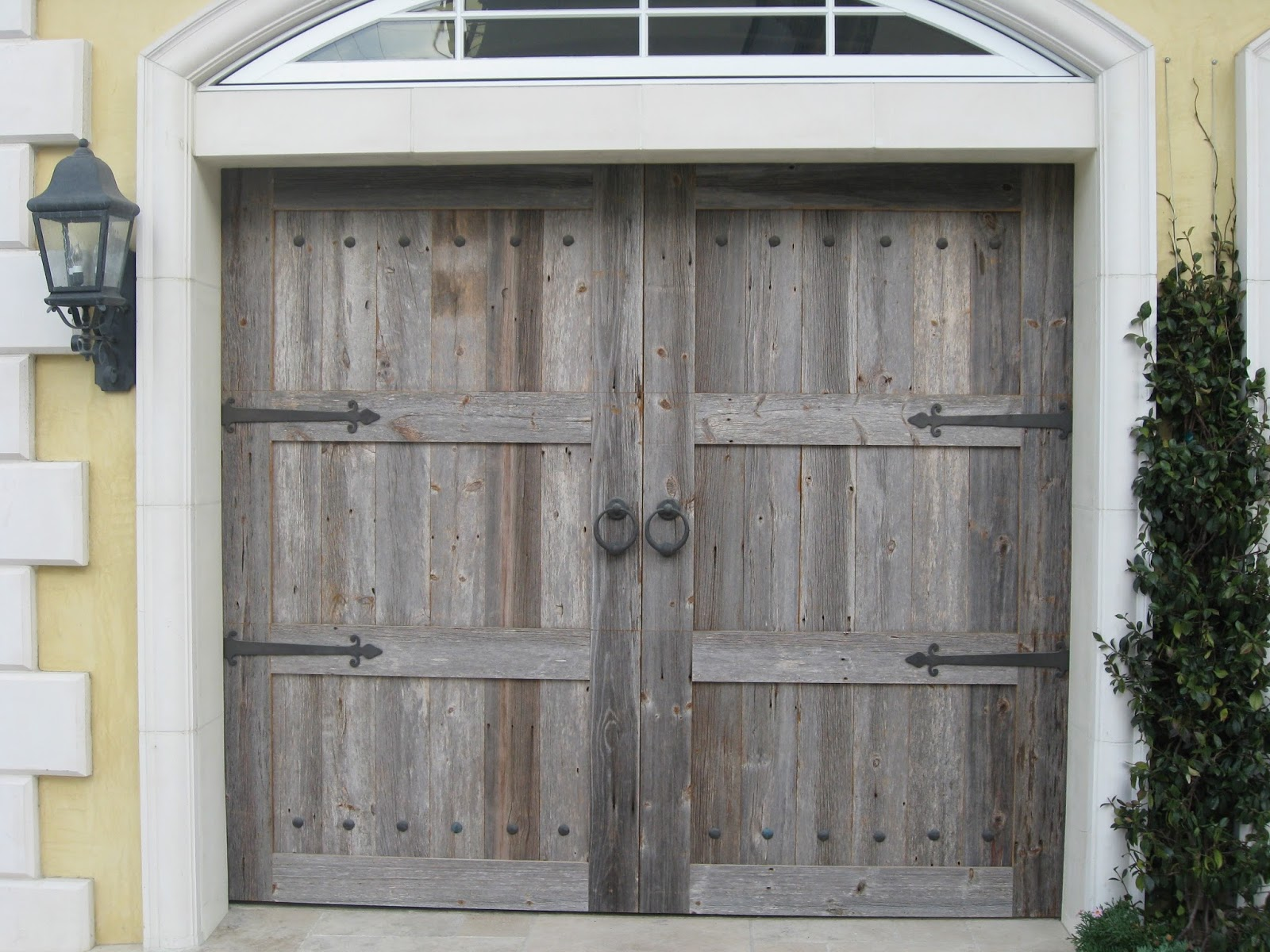 Romancing the home romancing the garage door another garage door made by the artisans that are making our door reclaimed barn wood rubansaba