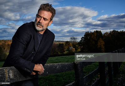 Jeffrey Dean Morgan leaning on a farm gate