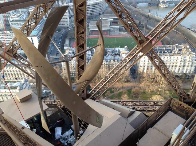 Wind turbine in Eiffel Tower (Credit: UGE)  Click to Enlarge.