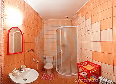 Fotos de ba os color naranja colores en casa for Accesorios bano naranja