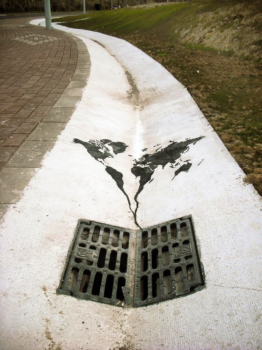 28 Pieces Of Street Art That Cleverly Interact With Their Surroundings - World Going Down The Drain, Spain