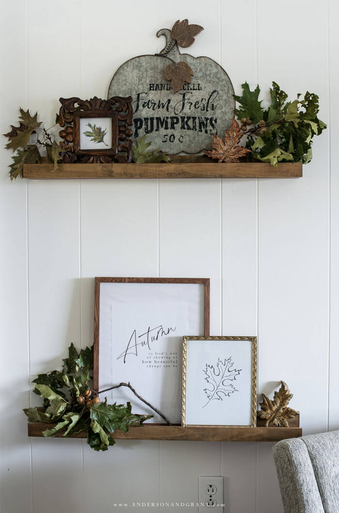 See how these narrow picture ledge shelves are transformed for fall with a variety of decor and leaves.