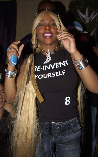 Lil Kim 're-invent yourself 8' shirt at Beyonce Birthday Party in 2001.  PYGear.com