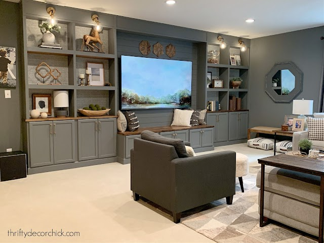 Basement family room wall with bookcases around TV