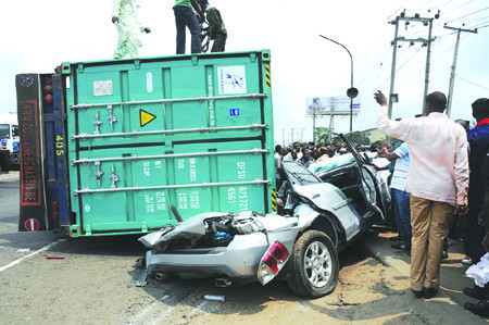 Three Lost their life as container falls off truck in Ogun
