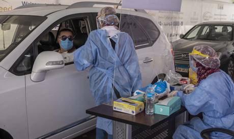 File photo: A health worker prepares to take swab samples to test for the coronavirus at a drive-through screening center in Cairo, Egypt. (AP)