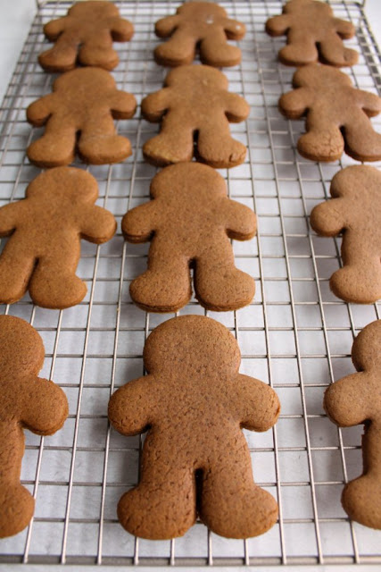 gingerbread man cookies cooling on wire rack