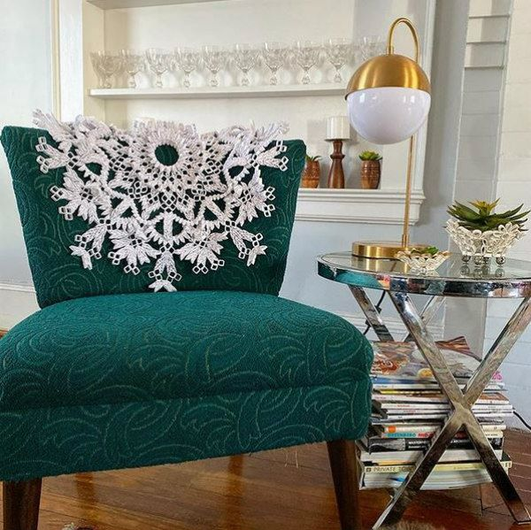 large-scale quilled paper doily displayed on chair back