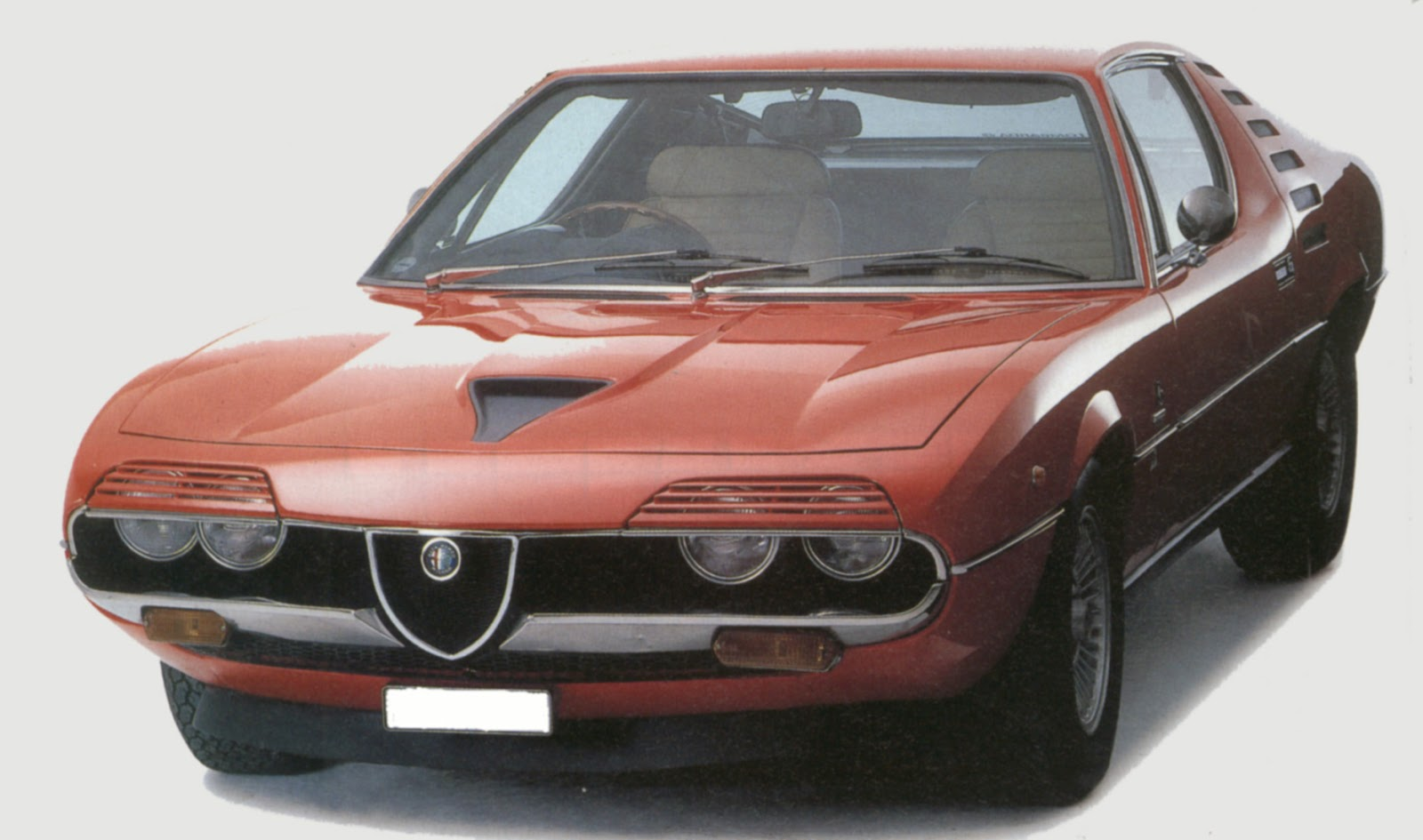 produced from 1971 to 1977 in limited numbers the montreal had a detuned lemans engine red hot italians alfa romeo  [ 1600 x 945 Pixel ]