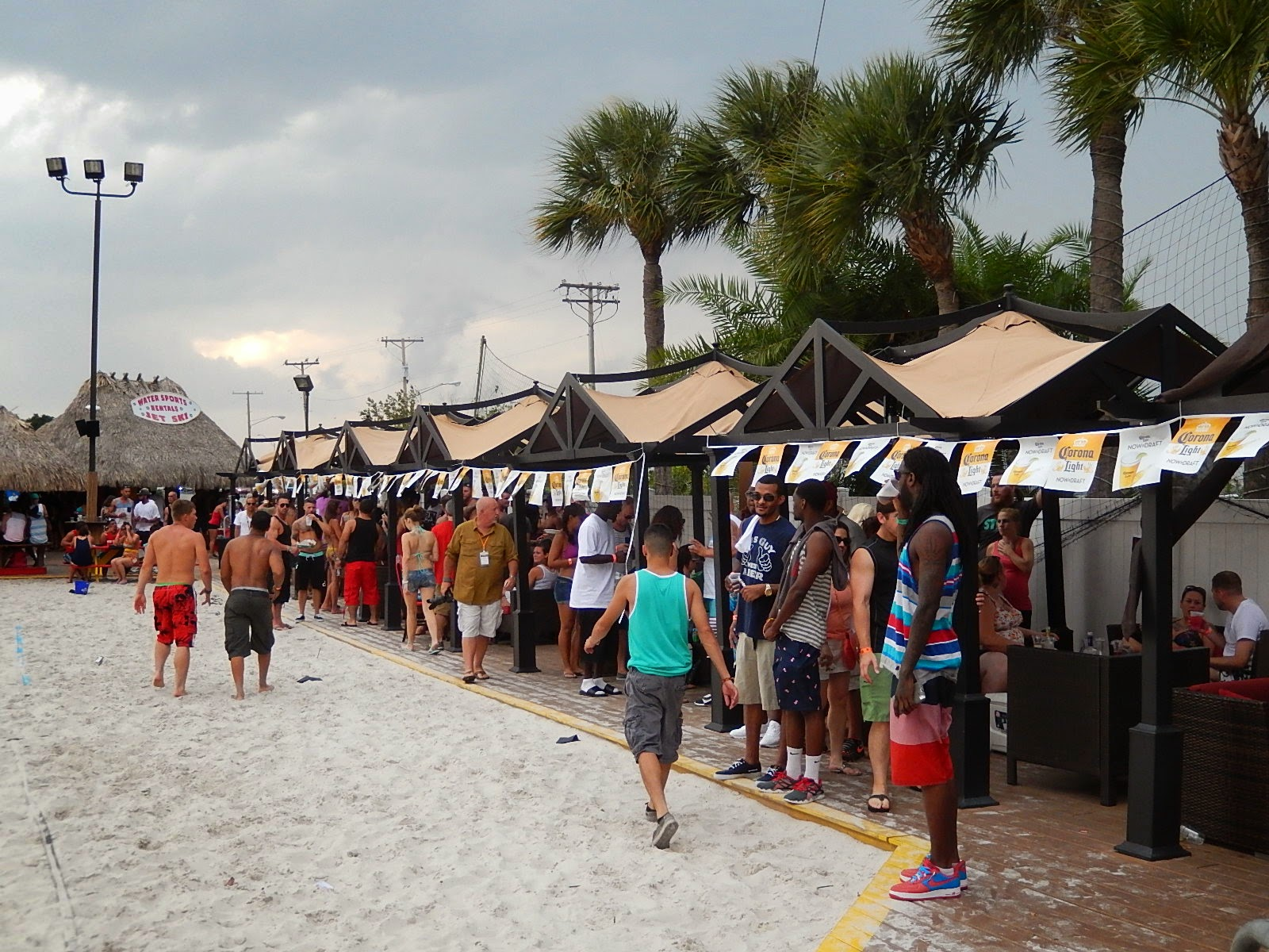 Made Up Of A Sandy Beach Area Surrounded By Tiki Huts The Dj Stage Was At Forefront
