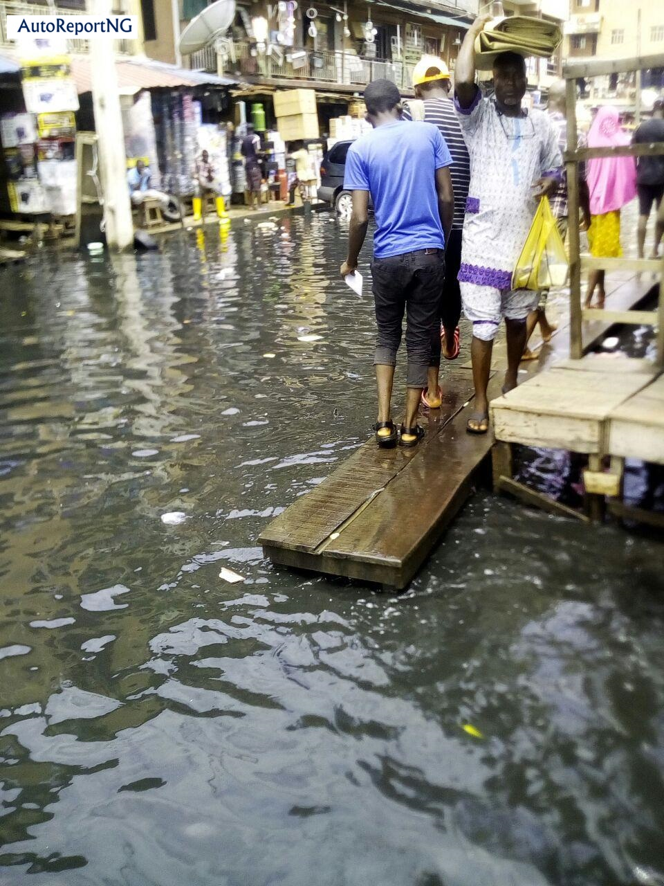 Flooded Jankara Market In Lagos Where Traders, Residents Wear Rain Boots To Work 7