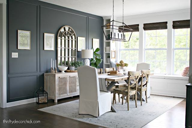 Morning/dining room with dark walls and built in window seat