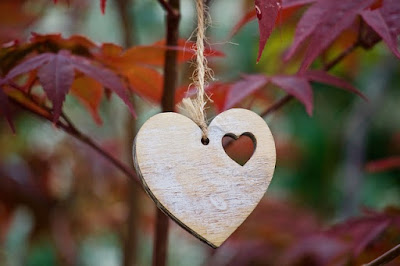 Photo of fall leaves and a silver heart