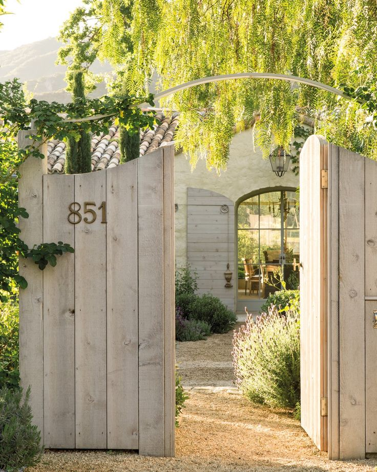Rustic wood gates to entrance of Patina Farm by Giannetti Home - found on Hello Lovely Studio