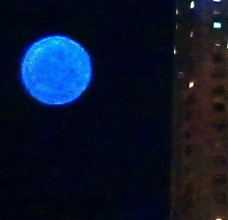 blue orb in sky