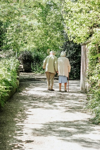 elderly couple walking and maintaining independence at home