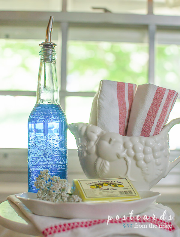 pretty glass bottle with spout used for liquid dish soap
