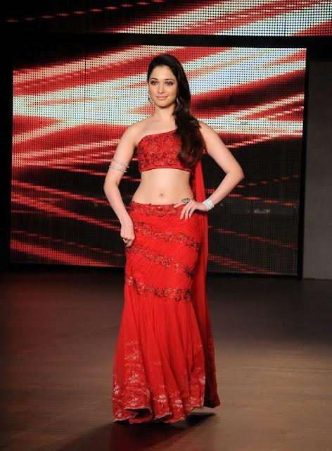 South Indian actress Tamanna Bhatia Looking Beautiful in Red Lehenga Saree