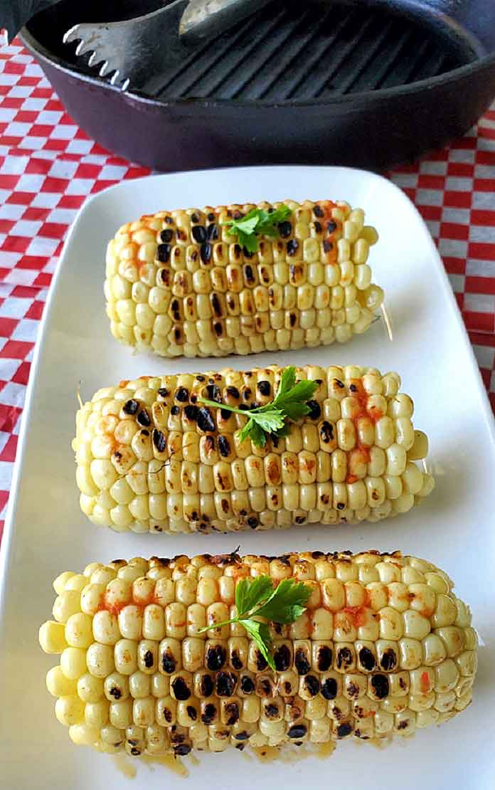 grilled corn on the cob with spicy sauce