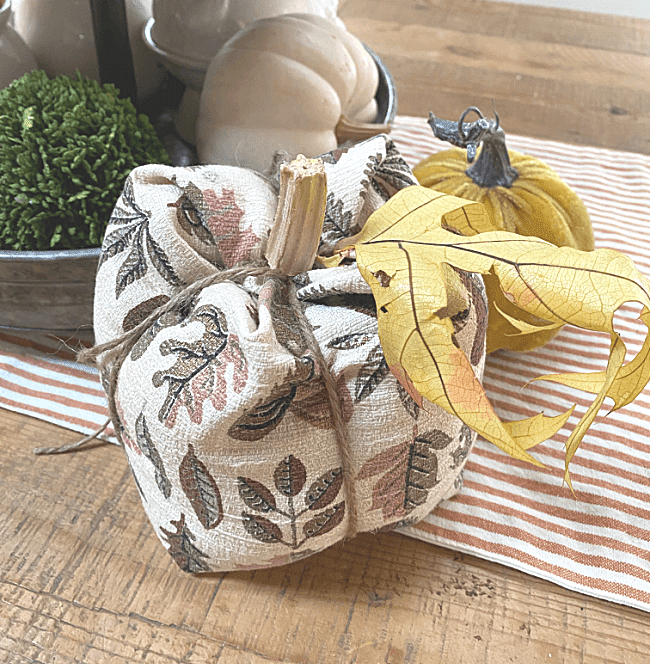 Vintage fabric pumpkin with yellow leaf