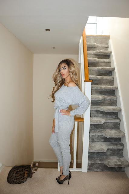 The Femme Luxe Grey Ribbed Off The Shoulder Loungewear Jumpsuit in model Harlow.