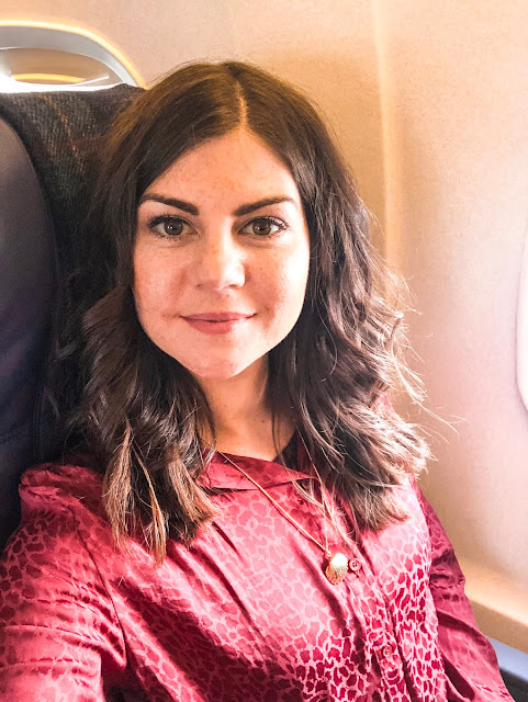 Solo travel in my 30s- selfie on the plane