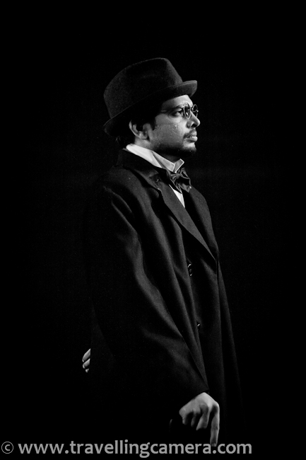 I hope you have already checked pre-interval stories from 'Chekhov ki Duniya', if not check out following link to know about this play and first three stories - http://www.travellingcamera.com/2011/12/chekhov-ki-duniya-part-1-nsd-play.htmlNext three stories are here...4th story from Chekhov ki Duniya was - Besahara Aurat, although story tells something else :)'Besahara Aurat' features a wild woman with a nervous disorder who tries to extort money from a banker.Cast of Besahara Aurat included - Aurat played by Rajini, Bank manager played by Kailash Chauhan, Pochetkin role played by Anirudh Wankar...Rajni and Kailash were two main actors in this story and both of them were awesome !!!'Dooba Hua Aadmi', a man in the 'maritime entertainment business' will drown himself for a small fee. This is only photograph I could click during this story due to extremely low light on stage. Cast of this story included :: Aadmi played by Anirudh Wanker, Writer played by Sunil Upadhyay, Policemen by Prasanna Soni...'The Gift' is a tale of a dedicated father who thrusts his shy, 19-year old son into manhood by taking him to a house of ill repute, only to relent at the last moment and leave the boy more perplexed than ever.Rajni played the role of a prostitute in this story and main conversation happened between Rajni and Deep, who was Father of the birthday boy.Here is a seen when a dad to talking to a prostitute for his son. Conversation was more about negotiation and some thoughtful things around the relationship of a son & father...Finally father realized that it was not a good gift for his son and came back to market to find something useful...With this story, Chekhov ki duniya ended with lots of noise in the auditorium... Everyone was really happy after the show...Prasanna Soni and Madhumita !!!Rajni and Deep Kumar !!!Kailash Chauhan & Jawed !!!Sunil Upadhayay - as Chekhov !!!