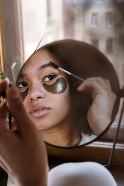 cosmetic surgery girl in mirror doing makeup