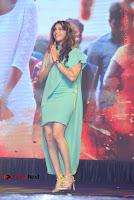 Actress Isha Koppikar Pos in Green Dress at Keshava Telugu Movie Audio Launch .COM 0044.jpg