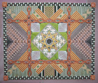 embroidered canvas with variety of stitches and fibres that create lots of texture